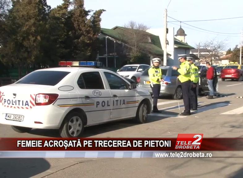 FEMEIE ACROȘATĂ PE TRECEREA DE PIETONI